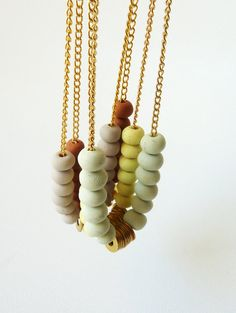 Beaded chain necklace with hardware