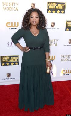 OPRAH WINFREY - 2014 Critics Choice Awards - The media maven wore an emerald green hued Azzedine Alaia dress, which was paired with a thin black bow belt and accompanied by Lorraine Schwartz jewels.