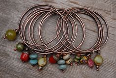 Bangles with Dangles by landscape jewel, via Flickr
