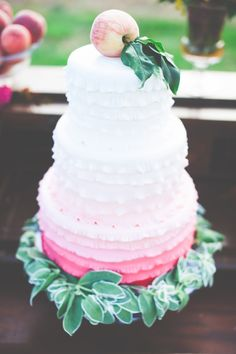 Ombre cake topped with a fresh peach