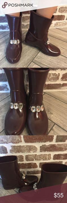 Fun and feminine Michael Kors rain boots Worn 2x. Size 8. Deep wine color. Slight pen mark on left shoe as pictured Shoes Winter & Rain Boots