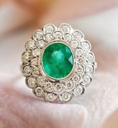 Lovely emerald and diamonds floral ring.