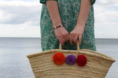 moroccan pom pom woven basket bag from postcards home