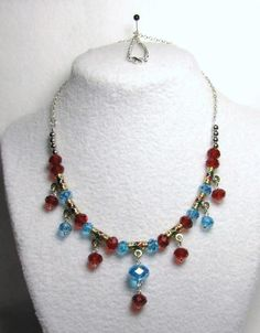 Crystal Jubilee Drops - Jewelry creation by Linda Foust Ruby Crystal, Aquamarine Crystal, Beaded Necklace, Necklaces, Jewelry Ideas, Red And Blue, Swarovski, Jewelry Making, Drop