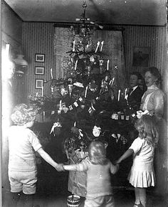 reminds me of me and the boys the night after the tree was decorated we had ...Family night dancing around the Christmas tree. Old photo from Allinge, Denmark
