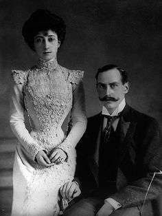 The King and the Queen of Norway. Check Maud's TINY WAIST. She had some GREAT dresses, too. (See the Anna Blanc fashion page)