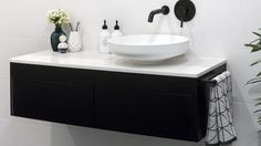 MAIN BATHROOM by Ben & Andy featuring a Rifco Acqua vanity in black satin with a Caesarstone top in Snow Laundry In Bathroom, Bathroom Inspo, Bathroom Black, Bathroom Ideas, Decorating Small Spaces, Coastal Decor, Black Satin, The Hamptons, Kitchen Decor