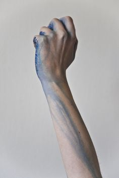A puddle of blue ink in her hand, closed in by her fist, running down her arm in little rivulets reminding her of streams and rivers and then the ocean, and then him.