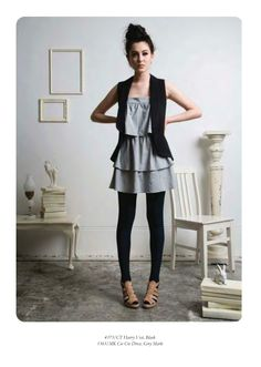 a flouncy dress, tights and a relaxed vest.  i never thought of this!