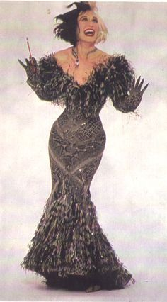 Cruella Deville in her snake print ostrich feather dress & matching gloves & diamond snake necklace.