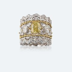 Buccellati Band ring with white and yellow gold, diamonds and yellow diamonds. https://facebook.com/DiamondDreamFineJewelers https://twitter.com/Diamond_Dream_ https://instagram.com/diamonddreamjewelers