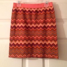 "Orange Chevron stretchy skirt Tag says ""S/M"" but it's much more like a small or XS. Super stretchy. Comfortable. Great condition. I've never worn it. Unknown Skirts Mini"