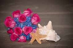 Bright Blue Hydrangea and Hot Pink Rose Wedding Bouquet. Bouquet by Sun Kissed Weddings.