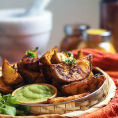 Baked spicy potato wedges seasoned with a tandoori masala rub. These potato wedges are crispy on the outside and remain moist inside.