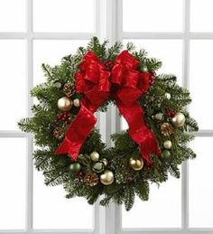The Winter Wonders Wreath showcases the festive feelings and holiday cheer of the season. The perfect adornment for any home or office!  Order your flowers today: http://texas-blooms.com/  #texasblooms #wreath #christms #holiday #decor