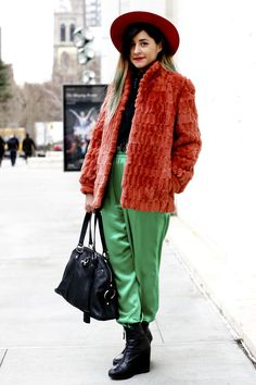 20 Ways to Wear Colorful Fur - bright orange fur coat + wide brimmed hat and green silk trousers