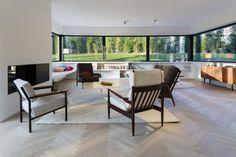 Under window storage, simplicity, window seats, fireplace, color of wood floors. Lighting needs work