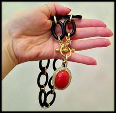 Black onyx, red coral, and 14k gold sautoir necklace by the Mazza company.
