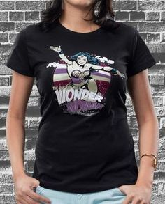 Beautiful, wise, swift, strong… is there anything Wonder Woman cannot do? Show off her seductive and ferocious powers with this retro print in pink and purple. Shop Now: http://voxpopclothing.com/wonder-woman/WBBT0003MBK #voxpopclothing #tee #tshirt #wonderwoman #superhero