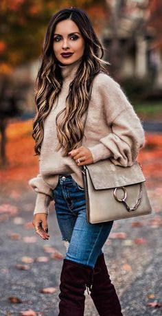 cozy winter outfit / nude sweater + bag + rips + over knee boots