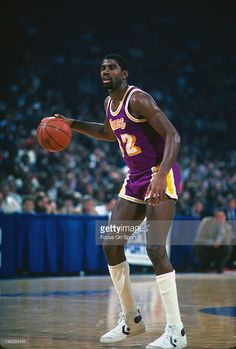 Earvin Magic Johnson #32 of the Los Angeles Lakers dribbles the ball against the Washington Bullets circa 1984 during an NBA basketball game at the Capital Center in Landover, Maryland. Johnson played for the Lakers from 1979 - 91, 96.