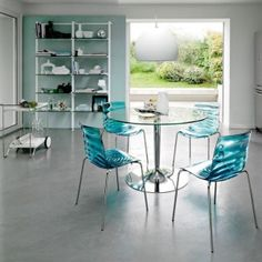 Stunning Minimalist Modern Round Glass Topped Kitchen Table With Stainless Basse Featuring Elegant Blue Glass Chairs