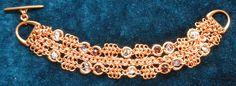 Copper chainmaille w/garnet, amethyst and clear quartz crystal gemstones https://www.etsy.com/ca/shop/SowilooCopper?ref=hdr_shop_menu