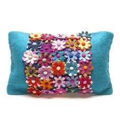 A feature piece for any home.  Be the envy of friends and foes with this sitting pretty on your sofa. A profusion of felt petals adorn this amazing home furnishing item. Handmade Felt.  Zip on reverse side and it comes with the cushion inside.50cm x 30cm. Find it online at: http://www.feltsogood.co.uk/home-gift/bliss-cushion.html