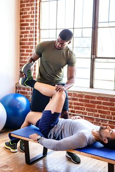 Fit coach stretching a client - Buy this stock photo and explore similar images at Adobe Stock Weight Training Workouts, Gym Workouts, Gym Trainer, Outdoor Gym, Free Yoga, Model Release, Muscle Men, Kettlebell