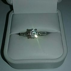 Beautiful Solitaire 925 Ring Russian Diamond Lovely Brand new never worn Ring Size 8.5 925 sterling silver stamped . Russian simulated 1 carat diamond solitaire ring. Encrusted diamond band . Wrapped  and shipped with care.  no box included Fire and Ice  Jewelry Rings