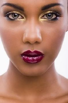 gold eyeshadow, plum lips...This will be my summer look minus the plum lips...how about a soft pink.