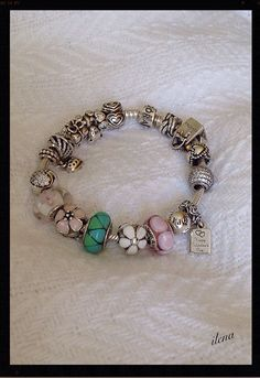 My silver, pink,  white and green Pandora bracelet. New darling daisies clip.