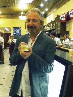 "-""CBGB"" star Alan Rickman grabs a scoop at Leopold's Ice Cream on July 22. Leopold's is celebrating its 93rd birthday in August. (Jesse Blanco/For Savannah Morning News)"