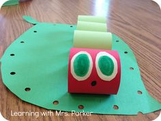 The Very Hungry Caterpillar Craft - love the hole punched leaf! To use with my TLC next year