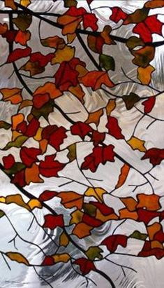 leaves in stained glass - love how the clear glass has the swirly look of water.