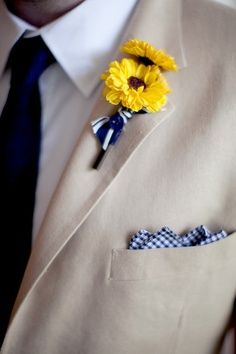 navy and yellow boutonniere