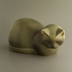Cat designed by Lisa Larson for Keramik Studio. Expresses her intimate understanding of cats, this one caught just before nodding off.