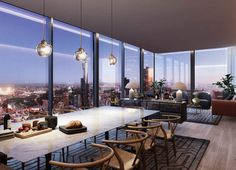 The penthouse has double height ceilings and floor-to-ceiling glass windows to exploit the 180 degree views.