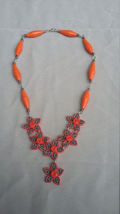Orange quilling necklace, quilling paper necklace, quilling paper flower, boho necklace, quilling necklace. Made of paper with quilling techniques in Orange and grey,paper beads and seed beads. Varnished with glossy water based varnish. Short necklace, neckline. Please note that the color may vary depending on your computer monitor setting. | Shop this product here: spreesy.com/Crochetbutique/52 | Shop all of our products at http://spreesy.com/Crochetbutique | Pinterest selling powered by…