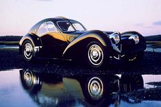 Bugatti 57 SC Atlantic 1938.  Forget the kids college fund.  Hard work is good for their character.
