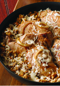 French Onion-Pork Chop Skillet – Served piping hot right out of the skillet, this dish with pork chops and golden brown sautéed onions is the embodiment of French country cuisine.