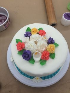 Champagne cake filled with orange curd = mimosa cake :). Cover with fondant with gum paste flowers.