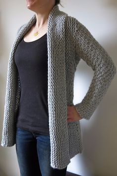 """Courie in"" is a Scottish phrase meaning to ""snuggle up"" - and it's the perfect name for this oversized, supremely warm, wrap front cardigan. This is a real winter warmer, ideal for nestling into with a mug of cocoa on a cold day. And it's so quick to knit! This cardigan has a slightly unusual construction. Sleeves are knitted first from cuff to centre back, then both sleeves are joined with a three needle bind off. Stitches are picked up at the bottom edge from armpit to armpit and worked…"