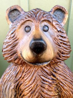 Cartoon-style brown bear chainsaw carving in Virginia Pine
