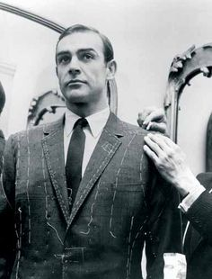 Sean Connery getting fitted for a suit by London tailor Anthony Sinclair.  Sinclair was the tailor of Terence Young, who directed the first, second, and fourth James Bond movies (Dr. No, From Russia With Love, and Thunderball).