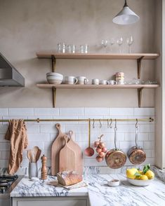 "deVOL Kitchens on Instagram: ""This pretty little image sort of encapsulates deVOL in some small way, the crackle metro tiles, the brass hanging rail with matching hooks,…"""