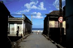 Old wooden houses line the shore in this eastern Caribbean town. Outdoor Photography, Color Photography, Amazing Photography, Street Photography, Cuba, David Alan Harvey, Alex Webb, William Eggleston, Photographer Portfolio