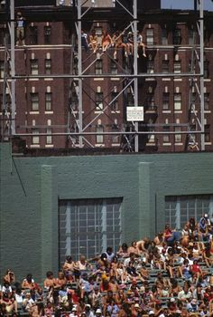 No net And NO cupholders!!     Red Sox fans sit on the scaffolding high above the Fenway Park bleachers during a 1975 game against Detroit