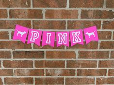 PINK Banner Perfect banner to set your PINK party over the top. Measurements: Each individual pennant measures about 4 inches by 4.5 inches. Full banner PINK measures approximately 2 feet with a foot of twine on each side for hanging. Colors: Hot Pink with White OR Black Letters.