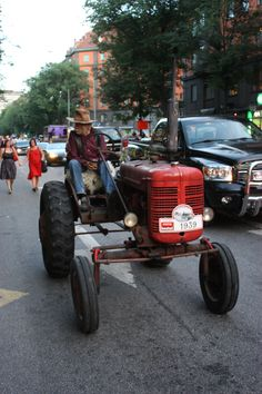 Old man on a tractor in Stockholm City